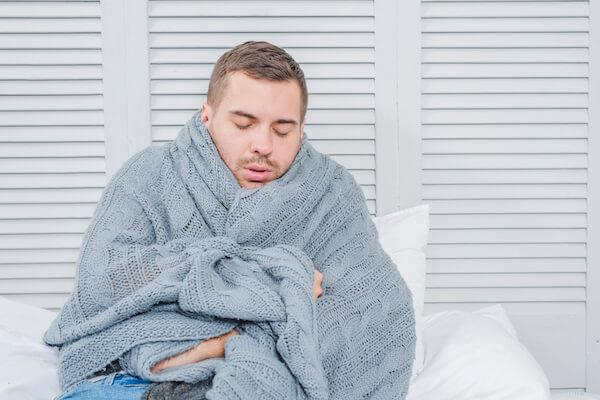 風邪の男性