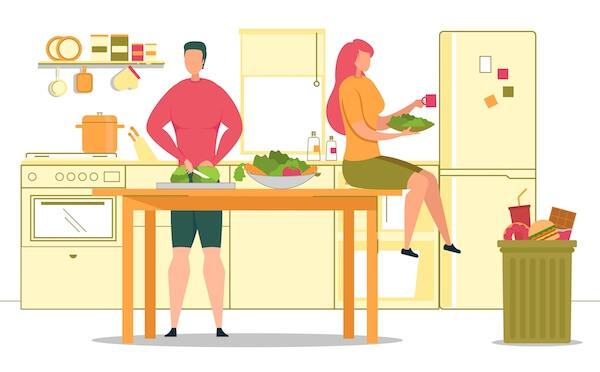 野菜を切る男性と女性